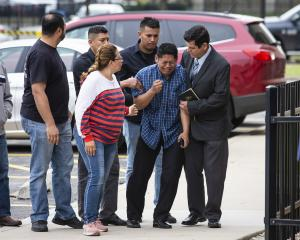 Arnulfo Ochoa is surrounded by family members and supporters, as he walks into the Cook County...