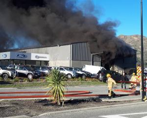 Firefighters at the scene of the blaze at Macaulay Motors. Photo: Supplied