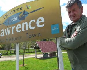 Lawrence-Tuapeka Community Board member Geoff Davidson by the South Otago town's sign last...