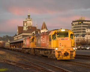 A train hauling wagons filled with coal from the Takatimu mine, in Southland, passes through...