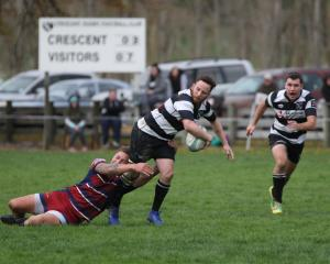 Crescent captain and first five-eighth Harley McHardy looks to offload the ball after being...