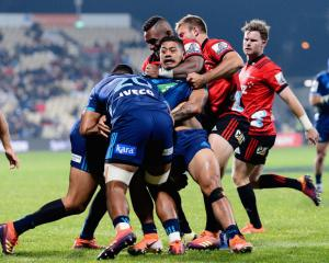 Augustine Pulu of the Blues is tackled by Sevu Reece of the Crusaders. Photo: Getty Images