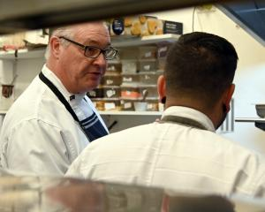 Michael Coughlin and Pablo Tacchini at work in Cucina's kitchen preparing for a Beef + Lamb...