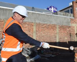 "Dr David Clark ""helps"" with the demolition of the building on the former Cadbury's car park site..."