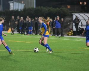 University player Erin Roxburgh looks to get past Mosgiel's Lauren Pendreigh (left) and Ella...