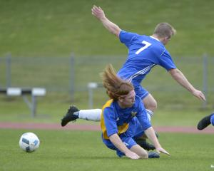 University's Tim O'Farrell challenges Mosgiel's Cam Anderson (on ground) in a top-of-the-table...