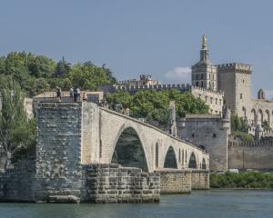 Avignon is encircled by a 4km wall complete with parapets and towers and the Medieval Pont Saint...