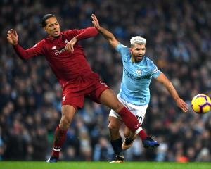 Liverpool's Virgil van Dijk tackles Manchester City's Sergio Aguero earlier in the season. Photo:...