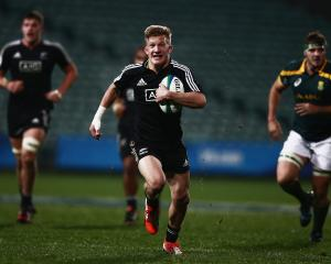Damien Mackenzie was a breakout star at the 2014 junior World Champions in Auckland. Photo: Getty...