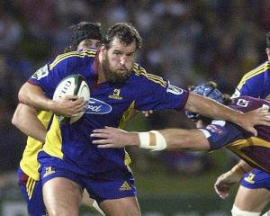 Carl Hayman of the Highlanders makes a break during a Super 14 match against the Queensland Reds....