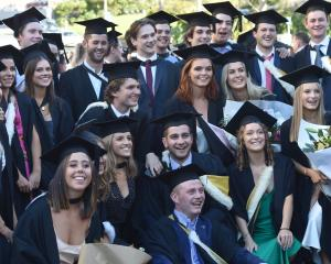 Graduates take part in the University of Otago graduation parade along George St on Saturday...