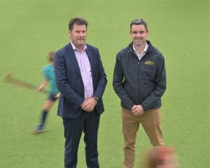 David Booth (left), from King's High School, and Andy McLean, from Otago Hockey, look to make...