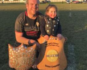 Karl Laurence and daughter Poppy (3) with some trophies won by the Edendale club last year. PHOTO...