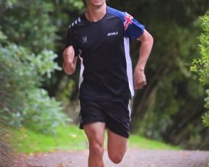 U20 Cross Triathlon champion Matthew Clough gets in a training run earlier this week. PHOTO: ...