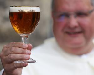 Norbertine Father Karel with a Grimbergen beer. Photo: Reuters