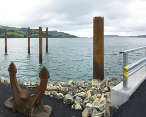 Piles, completed in March, will allow deck construction to start soon on a fishing jetty of...