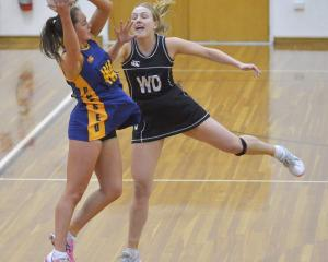 Physed wing attack Emily Henderson takes in a pass ahead of Southern Magpies wing defence Lauren...