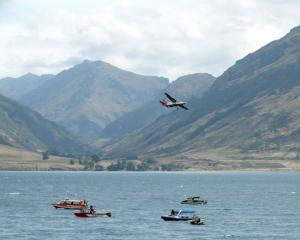 Searchers look for skydiver Tyler Nii, who landed in Lake Wakatipu, in January last year. Photos:...