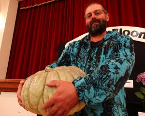 Richard Wallace, of Oamaru, holds his prize-winning pumpkin at the North Otago Horticultural...