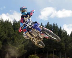 Palmerston motocross rider Courtney Duncan flies through the air at the Titri track, near Waihola...