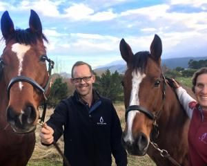 Michael Simpson holds Womrks Wonders, the dam of the weanling sold recently at Karaka, and Anna...