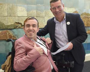 Disability rights campaigner Josh Perry (left) presents a petition to Dunedin-based National list...