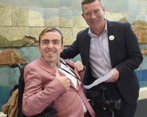 Joshua Perry hands over his disabled rights petition to Michael Woodhouse to present to...