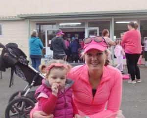 Bea and Izzy Tomlinson (21 months), of Dunback, get ready for the Palmerston Pink Ribbon Fun Run...