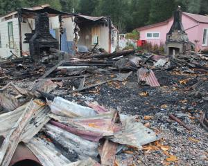 The homestead's charred remains, with the surviving accommodation wing at left. PHOTO: PARADISE...