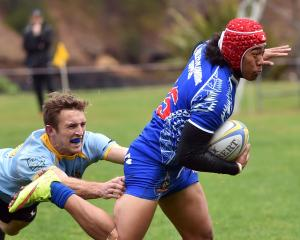 Harbour fullback Sala Halaleva gets past University first five-eighth Mike Williams during a...