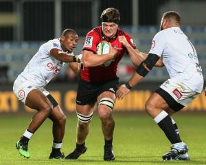 Scott Barrett of the Crusaders attempts to evade Makazole Mapimpi and Thomas du Toit of the...