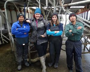Sharemilker and South Island Dairy Event committee member Amy Johnston (second left), of...