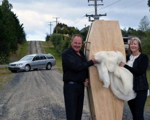 Exit Funeral Services co-owners Gary and Diane Shaw display a peren­dale wool lining destined for...