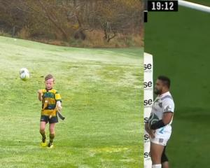 Jesse Pellowe, playing for Green Island, and Ben Smith celebrate with the same punching of the...