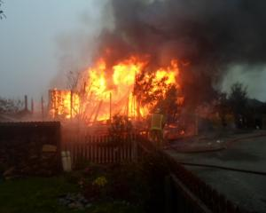 Firefighters battle a house fire at Riverside Village in Glenavy. Photo: supplied