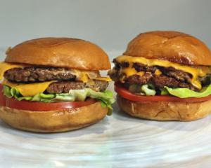 An Original Impossible Burger, left, and a Cali Burger, from Umami Burger, are shown in this...