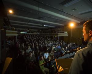 New Zealand Mountain Film Festival director Mark Sedon addresses a packed house at the Lake...