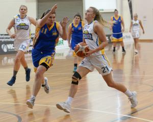 Tauranga City Coasters player Texi Schaeffer moves in front of Otago Goldrush's Nicole Ruske and...