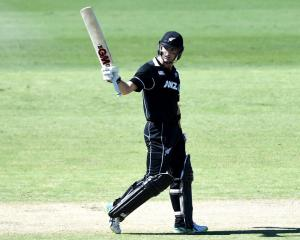 Will Young raises his bat during the New Zealand XI game against an Australia XI on Monday. Photo...
