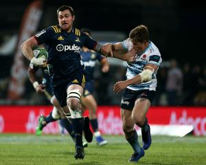 Highlanders flanker Liam Squire pushes off Waratahs halfback Nick Phipps in a strong run at Rugby...