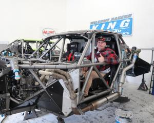 Phil 'LP' Casey at the wheel of his race truck while being reassembled in Mexico last month....