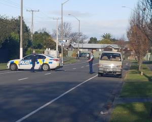 Armed police at a blockade on Wycliffe St, Napier. Photo: Blair Voorend via NZ Herald
