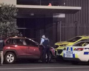 Police at the scene in Auckland following the death. Photo: NZ Herald