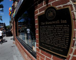 A man walks past the Stonewall Inn, site of the1969 Stonewall uprising, in Greenwich Village in...