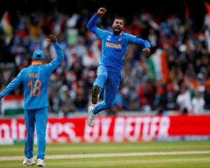 India's Hardik Pandya celebrates taking the wicket of Pakistan's Shoaib Malik. Photo: Reuters