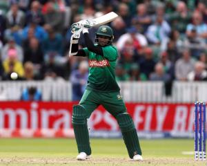Shakib Al Hasan hits out on his way to a century against the West Indies. Photo: Reuters