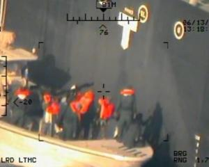 An image the Pentagon says was taken from a US Navy MH-60R helicopter shows members of the...