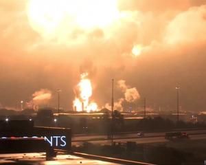 An explosion occurs during the fire at Philadelphia Energy Solutions Inc's oil refinery, in this...