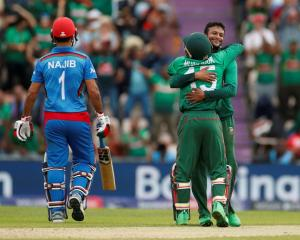 Bangladesh's Shakib Al Hasan and Mushfiqur Rahim celebrate taking the wicket of Afghanistan's...