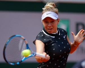 Amanda Anisimova plays a forehand during her win over Simona Halep at the French Open. Photo:...
